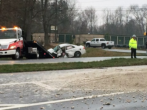 A dump truck traveling eastbound on Purple Heart Parkway struck the driver side of a four-door car traveling northbound on Evans Road.