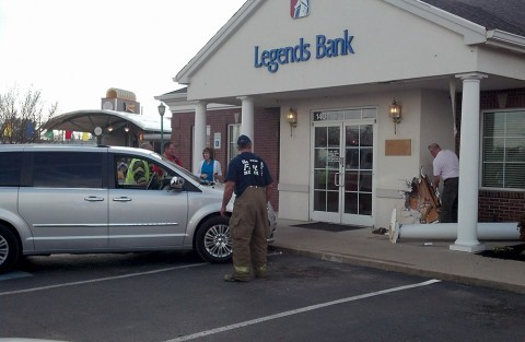 Vehicle crashes into the front of Legends Bank on Dover Road.