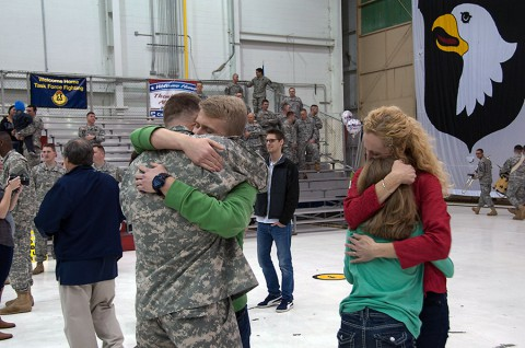 Division Chaplain (Lt. Col.) David Bowlus hugs his son Andrew, while his wife Meridee hugs their daughter Savannah, moments after reuniting during a welcome home ceremony March 11 at Fort Campbell. Bowlus was one of 59 Soldiers that returned from a deployment in support of Operation United Assistance. (Sgt. Leejay Lockhart, 101st Sustainment Brigade Public Affairs)