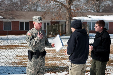 Spc. Brian Coates, a military police officer assigned to the 218th Military Police Company, 716th Military Police Battalion, supported by the 101st Sustainment Brigade, 101st Airborne Division, questions Spc. Trenton Taitague, a member of the Fort Campbell Special Reaction Team portraying a domestic abuse perpetrator, during a domestic violence training scenario Feb. 26 at Fort Campbell.  (Sgt. Leejay Lockhart, 101st Sustainment Brigade Public Affairs)