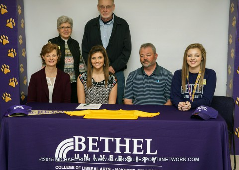 Molly Brewer with her family at the Bethel University signing ceremony, Friday