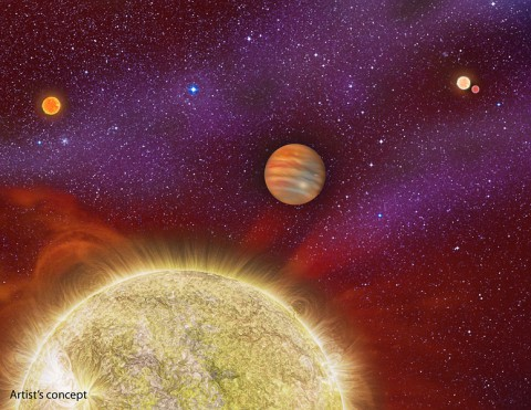 This artist's conception shows the 30 Ari system, which includes four stars and a planet. The planet, a gas giant, orbits its primary star (yellow) in about a year's time. (Karen Teramura, UH IfA)