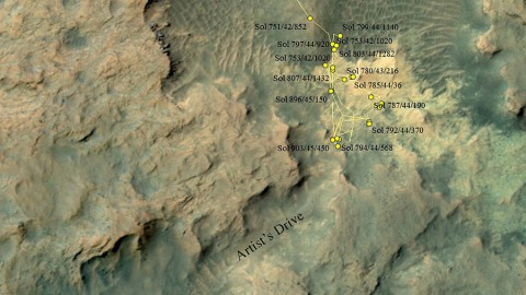 """This area at the base of Mount Sharp on Mars includes a pale outcrop, called """"Pahrump Hills,"""" that NASA's Curiosity Mars rover investigated from September 2014 to March 2015, and the """"Artist's Drive"""" route toward higher layers of the mountain. (NASA/JPL-Caltech/Univ. of Arizona)"""