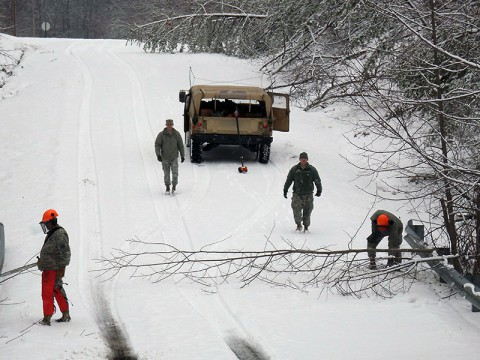 Personnel from the Tennessee National Guard's 278th Armored Cavalry Regiment clear debris from the destructive winter storm that devastated portions of Fentress, Overton, and Putnam Counties from Cookeville to Crossville, Tennessee, February 26th.