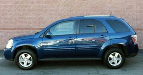 The 2009 Chevy Equinox in this photo is an example of what the suspect's vehicle looks like. This is not the actual suspect's vehicle.