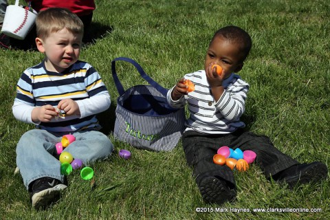 Two little ones having fun at the Easter Egg Hunt.