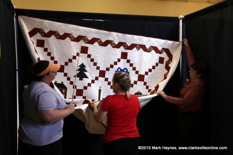Quilts being hung for the Rivers and Spires Quilts of the Cumberland Quilt Show.