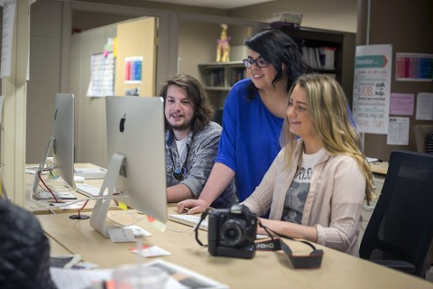 Sean McCully, left, Jennifer Smith, and Taylor Slifko work on an edition of The All State in the Student Publications office on Monday, April 13th, 2015. (Beth Liggett, APSU)