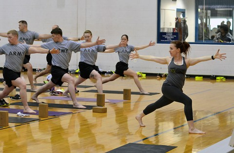 Connie Simmons, a yoga instructor with Joined Forces Yoga, instructs a class to Soldiers with the 2nd Brigade Combat Team, 101st Airborne Division, during one of the weekly classes offered by Joined Forces Yoga. Joined Forces Yoga is a nonprofit organization that provides free yoga classes to service members, veterans, family members and Department of Defense civilians. (U.S. Army photo by Sgt. Sierra A. Fown, 2nd Brigade Combat Team, 101st Airborne Division (Air Assault) Public Affairs)