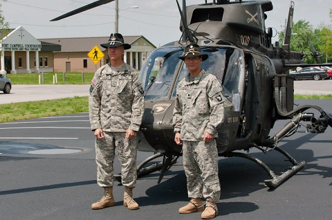 Chief Warrant Officer 5 Bud Kenney, left, brigade maintenance officer, Headquarters and Headquarters Company, and Lt. Col. Jack Murphy, commander, 2nd Squadron, 17th Cavalry Regiment, 101st Combat Aviation Brigade, 101st Airborne Division (Air Assault), pose in front of an OH-58D Kiowa Warrior helicopter, before transferring it to the Don F. Pratt museum, Fort Campbell, Ky., April 22, 2015. (Sgt. Duncan Brennan, 101st CAB Public Affairs)