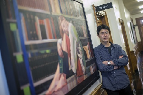 "Artist Takuya Kanemitsu poses next to his painting ""After the Library Closed"" in the Browning Administration Building. (Beth Liggett, APSU)"