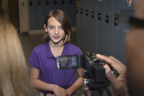 Sixth grader Holly Widen speaks with reporters at Wassom Middle School Tuesday after a ceremony recognizing her lifesaving actions in performing the Heimlich maneuver to clear her father's obstructed airway. (David E. Gillespie)