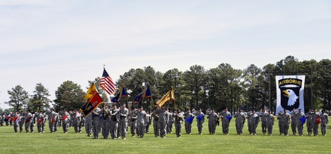 Soldiers from the 159th Combat Aviation Brigade, 101st Airborne Division (Air Assault), pay honors to the nation during the national anthem at the Thunder Brigade's inactivation ceremony at the division parade field on Fort Campbell, Ky., May 7, 2015. The 159th CAB cased its brigade colors for the final time during the ceremony, as well as all of its subordinate battalion colors and company guidons. (Staff Sgt. Joel Salgado, 3rd Brigade Combat Team, 101st Airborne Division (Air Assault) Public Affairs)