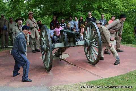 Kenwood Elementary School 5th Graders watch the 14th Tennessee Infantry reenactors demonstrate how artillery was fired at Fort Defiance Civil War Park, Friday.
