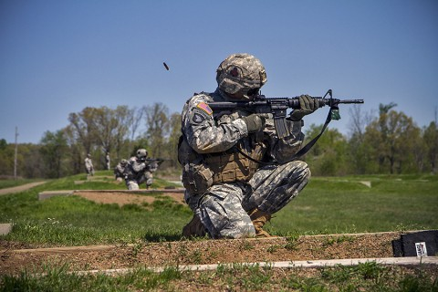 Sgt. Nathan Joachim, Company D, 1st Brigade Combat Team, 101st Airborne Division (Air Assault), fires his M4 rifle while in the kneeling unsupported firing position on a range here during the division's 2015 Soldier and noncommissioned officer of the year April 23, 2015. Joachim, is a native of Katy, Texas. (Staff Sgt. Terrance D. Rhodes, 101st Airborne Division (Air Assault) Public Affairs)