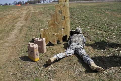 """A Soldier in Company D """"Maddogs,"""" 1st Battalion, 327th Infantry Regiment, 1st Brigade Combat Team, 101st Airborne Division (Air Assault), shoots at a 200 meter target during the best shooter competition April 9. Soldiers had to maneuver around barriers when shooting, then transport various challenges to the next barrier. (Sgt. Samantha Parks, 1st Brigade Combat Team)"""