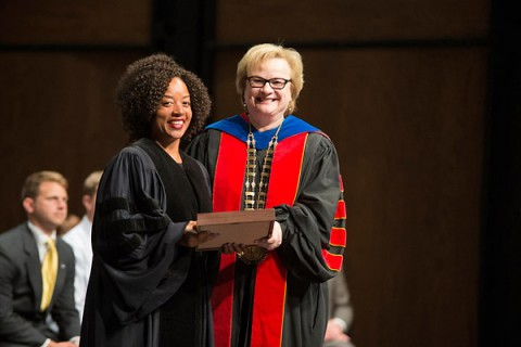 Austin Peay President Alisa White presents Dr. Dwonna Goldstone, professor of languages and literature, with the Richard M. Hawkins Award. (Adison Hardyway/APSU)