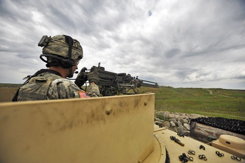 A Soldier assigned to Company D, 1st Battalion, 187th Infantry Regiment, 3rd Brigade Combat Team, 101st Airborne Division, engages targets at St. Vith Range at Fort Knox, KY, April 30th, 2015. The Soldiers from Dragon Company trained at Fort Knox as part of a crew, section and platoon certification used to verify the heavy weapons company's ability to provide fire support to the battalion's rifle companies. (Staff Sgt. Joel Salgado, 3rd Brigade Combat Team, 101st Airborne Division (air Assault) Public Affairs)