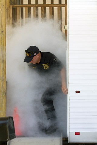 Darrell Brantley, a member of the Fort Campbell fire prevention team, demonstrates exiting a trailer that simulates smoke filled houses to members of the 716th Military Police Battalion, supported by the 101st Sustainment Brigade, 101st Airborne Division, during a battalion safety training exercise May 1, 2015, at Fort Campbell, Ky. Fire prevention was one of several safety topics the battalion trained on during the event. (Sgt. Leejay Lockhart, 101st Sustainment Brigade, 101st Airborne Division (Air Assault) Public Affairs)