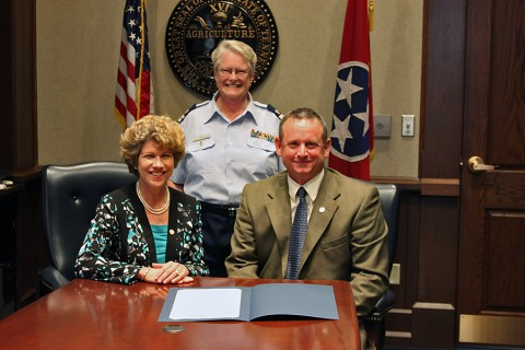 Jim Durrett, Mayor of Montgomery County and Kim McMillian,  Mayor of the City of Clarksville, standing Diane Gilman, USCG Auxiliary Flotilla Commander 082-11-07, Clarksville/Fort Campbell.
