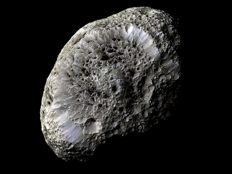 This false-color view of Hyperion was obtained during Cassini's closest flyby of Saturn's odd, tumbling moon on Sept. 26, 2005. (NASA/JPL-Caltech/SSI)