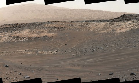 This May 10, 2015, view from Curiosity's Mastcam shows terrain judged difficult for traversing between the rover and an outcrop in the middle distance where a pale rock unit meets a darker rock unit above it. The rover team decided not to approach this outcrop and identified an alternative. (NASA/JPL-Caltech/MSSS)