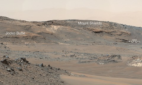 """This April 16th, 2015, panorama from the Mast Camera on NASA's Curiosity Mars rover shows a detailed view toward two areas on lower Mount Sharp chosen for close-up inspection in subsequent weeks: """"Mount Shields"""" and """"Logan Pass."""" (NASA/JPL-Caltech/MSSS)"""