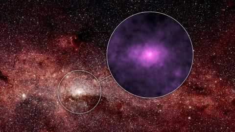 NASA's Nuclear Spectroscopic Telescope Array, or NuSTAR, has captured a new high-energy X-ray view (magenta) of the bustling center of our Milky Way galaxy. (NASA/JPL-Caltech)