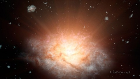 This artist's concept depicts the current record holder for the most luminous galaxy in the universe. (NASA/JPL-Caltech)