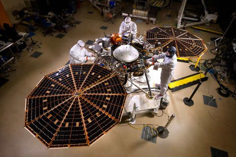 The solar arrays on NASA's InSight lander are deployed in this test inside a clean room at Lockheed Martin Space Systems, Denver. This configuration is how the spacecraft will look on the surface of Mars. The image was taken on April 30, 2015. (NASA/JPL-Caltech/Lockheed Martin)