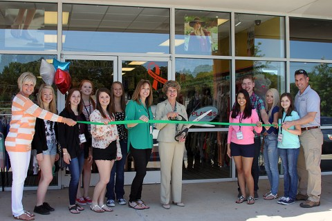 Plato's Closet green ribbon cutting ceremony. (L to R) Melinda Shepard; Ashley, Leslie, Nicole, Amanda, Vivian, Brandy Vaughn, Mayor McMillan, Stephanie, Chris, Taylor, Hannah and Jim Vaughn.