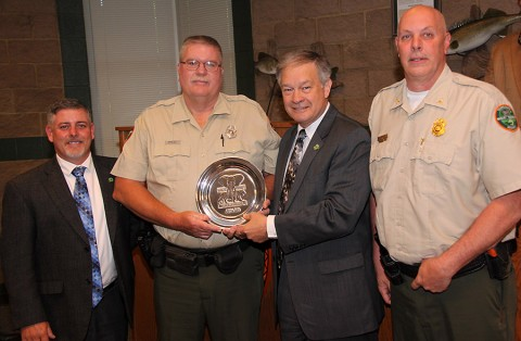 Wayne Rich (second from left) is the Tennessee recipient of the 2014 Shikar-Safari Club International TWRA Officer of the Year. He was presented the award at the May meeting of the Tennessee Fish and Wildlife Commission. Also pictured (from left) are TFWC Chairman Jim Bledsoe, TWRA Executive Director Ed Carter, and TWRA Boating and Law Enforcement Division Chief Darren Rider.