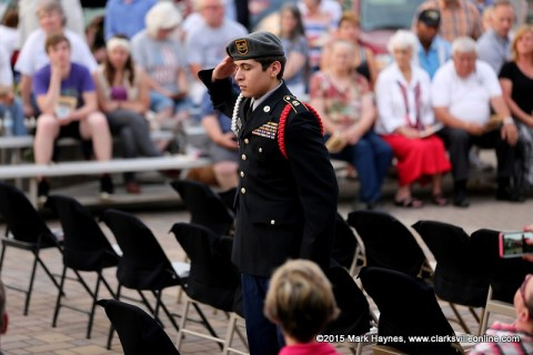 A Montgomery Central JROTC Cadet salutes a chair recognizing a missing soldier