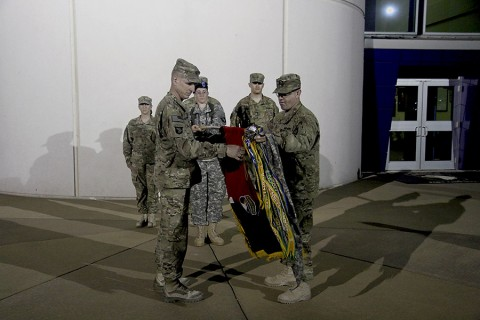 "1st Brigade Combat Team ""Bastogne"" Soldiers uncase colors after returning home from Afghanistan Sunday. (U.S. Army)"