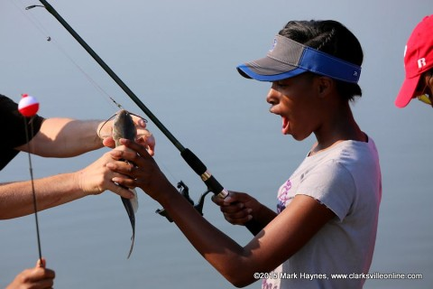 This young lady caught her first fish ever at Saturday's Youth Fishing Rodeo.