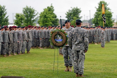 Col. John W. Brennan, the commander of the 5th Special Forces Group (Airborne), prepares to move a memorial wreath into place during the annual 5th SFG(A) Memorial Ceremony on Gabriel Field, May 16, 2015, at Fort Campbell, KY. (Sgt. Justin A. Moeller, 5th SFG(A) Public Affairs)