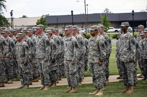 """Soldiers from the Wisconsin and Utah Army National Guard and U.S. Army Reserve sing the Army song after donning the historic """"Old Abe"""" patch ceremony at 101st Division Headquarters, at Fort Campbell, Ky., June 16, 2015. (Staff Sgt. Terrance D. Rhodes, 2nd Brigade Combat Team, 101st Airborne Division (AA) Public Affairs)"""