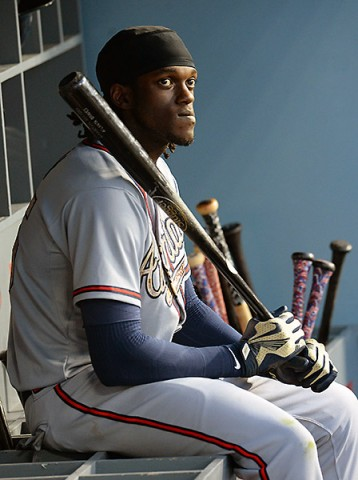 Atlanta Braves center fielder Cameron Maybin (25) sits in the dugout during the ninth inning of the game against the Los Angeles Dodgers at Dodger Stadium. (Jayne  Kamin-Oncea-USA TODAY Sports)