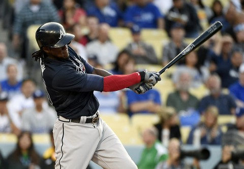 Atlanta Braves center fielder Cameron Maybin (25) singles against the Los Angeles Dodgers during the first inning of the game at Dodger Stadium. (Richard Mackson-USA   TODAY Sports)