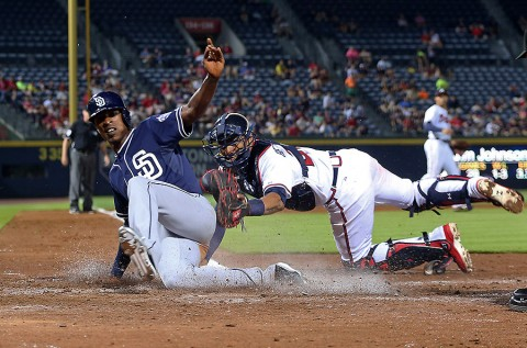 Atlanta Braves catcher Christian Bethancourt (27) tags out San Diego Padres Melvin Upton, Jr. (2) in the eighth inning at Turner Field. The Braves won   6-5. (Jason Getz-USA TODAY Sports)
