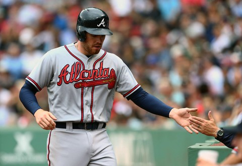 Atlanta Braves first baseman Freddie Freeman (5) celebrates after scoring a run against the Boston Red Sox during the fourth inning at Fenway Park. (Mark L. Baer-USA TODAY Sports)