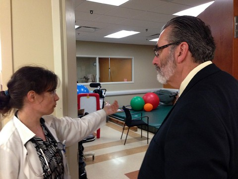 Dr. Silke Bernert, medical director for TBI and Acquired Brain Injury Unit at Cardinal Hill Hospital in Lexington, KY, shows Dr. Bret Logan, director of the Fort Campbell Intrepid Spirit, her physical and occupational therapy rooms at Cardinal Hill. Bernert serves as part of the scientific and medical advisory board in Lexington, KY.