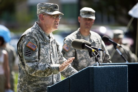"""During a change of command ceremony at Blanchfield June 15, Col. George """"Ned"""" Appenzeller asks Col. Telita Crosland to """"take care of the BACH family so it can continue taking the absolute best care of Soldiers, families and this great community."""" (U.S. Army photo by David E. Gillespie)"""