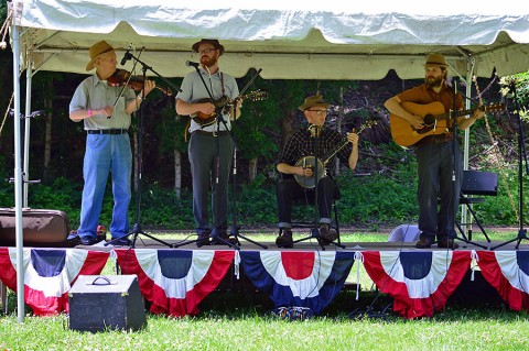 The Homeplace Pickin' Party offers fun for everyone. Visitors enjoy the scenery on the farm, as well as some old-time music under the shade trees. Photo by Kelly Best Bennett. (Land Between the Lakes)