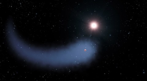 "This artist's concept shows ""The Behemoth,"" an enormous comet-like cloud of hydrogen bleeding off of a warm, Neptune-sized planet just 30 light-years from Earth. Also depicted is the parent star, which is a faint red dwarf named GJ 436. The hydrogen is evaporating from the planet due to extreme radiation from the star. A phenomenon this large has never before been seen around any exoplanet. (NASA, ESA, and G. Bacon (STScI))"