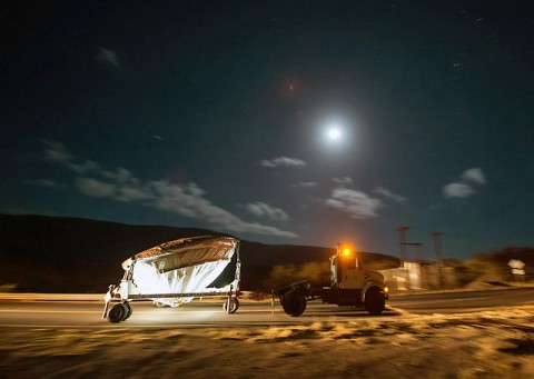 NASA's Low Density Supersonic Decelerator (LDSD) test vehicle is rolled out to the launch pad under moon light, Wednesday, June 3, 2015, at the U.S. Navy Pacific Missile Range Facility (PMRF) in Kauai, Hawaii. (NASA/Bill Ingalls)
