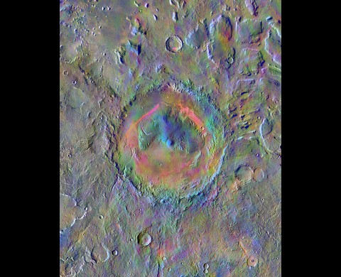 Gale Crater, home to NASA's Curiosity Mars rover, shows a new face in this image made using data from the THEMIS camera on NASA's Mars Odyssey orbiter. The colors come from an image processing method that identifies mineral differences in surface materials and displays them in false colors. (NASA/JPL-Caltech/Arizona State University)