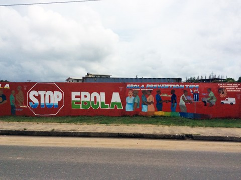 A banner found on the outskirts of Monrovia, Liberia, during the Ebola outbreak that affected thousands of Liberians in 2014 and 2015. In October 2014 during the peak of the outbreak, Rivera deployed to hammer out leases and land-use agreements for Operation United Assistance, a humanitarian assistance mission aimed to combat the Ebola crisis in Liberia. (Courtesy Photo)