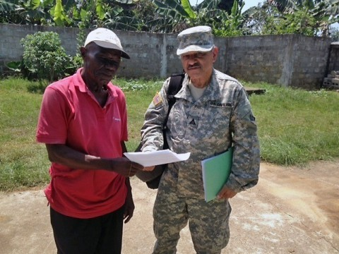 Angel Rivera, a Corps realty assistant, works with Liberian officials to hammer out leases and land-use agreements for Operation United Assistance, a humanitarian assistance mission aimed to combat the Ebola epidemic killing thousands of Liberians. Rivera deployed with eight Army civilian volunteers and four Soldiers comprising the North Atlantic Division's Forward Engineering Support Team, or FEST. (Courtesy Photo)
