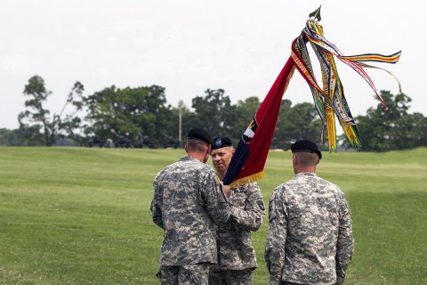 Maj. Gen. Gary J. Volesky, commanding general of the 101st Airborne Division passes the Strike colors to Col. Brett G. Sylvia during 2nd Brigade Combat Team's change of command ceremony here, June 26, 2015. The passing of the guidon signifies Sylvia's official assumption of command. (Staff Sgt. Terrance D. Rhodes, 2nd Brigade Combat Team, 101st Airborne Division (Air Assault) Public Affairs)